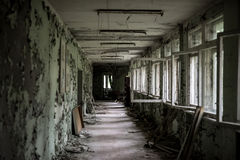 School room with turned chairs and opened window frames in Pripyat Stock Images