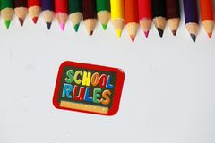 School rules character ,School supplies colored pencils in Fall scattered,  Royalty Free Stock Photography