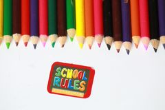 School rules character ,School supplies colored pencils in a row, isolated Royalty Free Stock Photography
