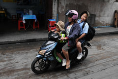 School Run by Motorbike Royalty Free Stock Image