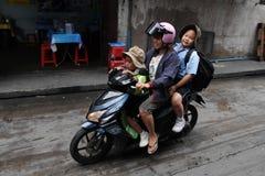 School Run by Motorbike royalty free stock image