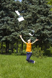 School's out !. Young girl celebrating the end of the school year stock image