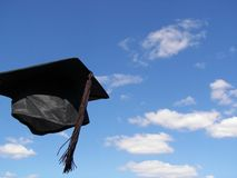 Airborne black graduation cap  Royalty Free Stock Images