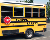 School Safety. The words School safety are written on a yellow school bus Stock Image