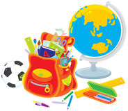 School satchel, globe, football. Globe, football, school satchel with books and stationery for a first grader Royalty Free Stock Photos