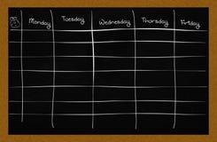 School schedule. A school schedule on a blackboard Stock Images