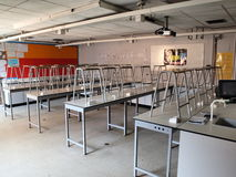 School science lab. A school Science lab with stools on the benches Royalty Free Stock Images