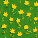 School season seamless background.. Yellow maple leaves with stalks in the form of school supplies on green blackboard background as symbol of beginning of the Stock Images