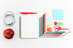 School set with notebooks, pencils, brush, scissors and apple on white background Stock Images
