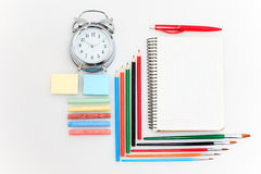 School set with notebooks, pencils, brush, scissors and apple on white background Stock Image
