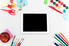 School set with notebooks, pencils, brush, scissors and apple on white background Stock Photos