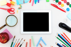 School set with notebooks, pencils, brush, scissors and apple on white background Stock Photography