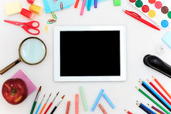 School set with notebooks, pencils, brush, scissors and apple on white background Royalty Free Stock Images