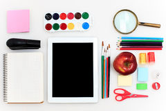 School set with notebooks, pencils, brush, scissors and apple on white background Royalty Free Stock Photography