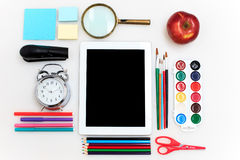 School set with notebooks, pencils, brush, scissors and apple on white background Royalty Free Stock Photos