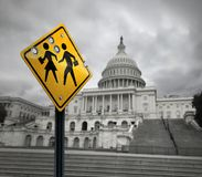 School Shooting Government Issue. Symbol and tragic gunfire towards students as a sad sign with bullet holes with washington congress in the United States with Stock Photo