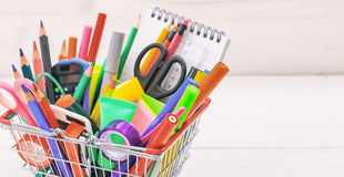 School shopping basket on white background. School supplies in a shopping basket on white background Stock Photography