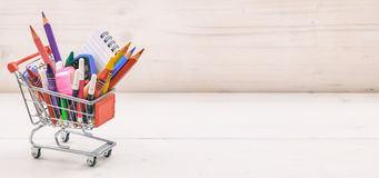 School shopping cart on white background. School supplies in a shopping cart on white background Royalty Free Stock Photography