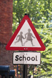 School sign. A UK road sign warning motorists of children around a school location Royalty Free Stock Photo