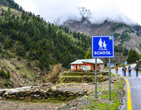 School Sign Board in Naran Valley, Pakistan. Naran & Kaghan are the most beautiful towns in Pakistan. Thousands of tourists travel here to see wonderful valleys Royalty Free Stock Photo
