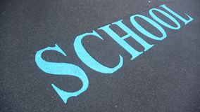 SCHOOL sign on ground Stock Image
