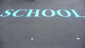 SCHOOL sign on ground Royalty Free Stock Photos