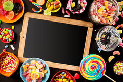 School slate surrounded by colorful candy Royalty Free Stock Images