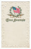 School Souvenir Postcard 1901. School class souvenir postcard from 1901 featuring the American flag surrounded by a wreath and torches.  Antique white embossed Stock Image