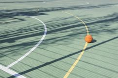 School sport ground outdoor.Basketball ball on the empty sport court stock images