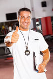 School sports coach. Professional male school sports coach giving thumb up Royalty Free Stock Photo