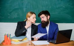 School staff. School collective and relations between colleagues. Professional differences. Teacher and supervisor. Working in school classroom. School educator stock photos
