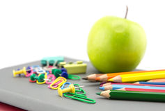 School stationery and apple green Royalty Free Stock Images