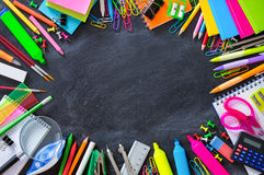 School stationery on blackboard framing Royalty Free Stock Photography