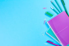 School stationery on blue background with copyspace Royalty Free Stock Photos