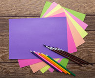 School stationery:cozy colors paper and pencil and brush on wood background Stock Images