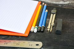 School stationery frame on wooden background-6. School stationery Royalty Free Stock Photo