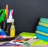 School stationery laid on a background of chalkboard Stock Photography