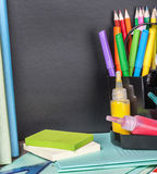 School stationery laid on a background of chalkboard Royalty Free Stock Photos