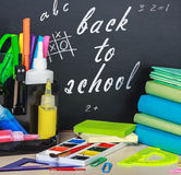 School stationery laid on a background of chalkboard Stock Image