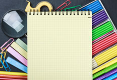 School stationery laid out on the notepad Royalty Free Stock Images