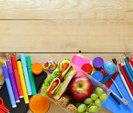 School stationery and lunch box with apple and sandwich Royalty Free Stock Photography