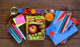 School stationery and lunch box with apple and sandwich Stock Photo