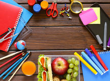 School stationery and lunch box with apple and sandwich Stock Photography