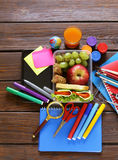 School stationery and lunch box with apple and sandwich Royalty Free Stock Photos