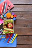 School stationery and lunch box with apple and sandwich Stock Photos