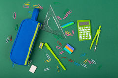 School stationery. School office stationery on green background Stock Photography