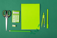 School stationery. School office stationery on green background Royalty Free Stock Photo