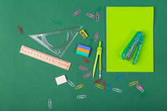 School stationery. School office stationery on green background Royalty Free Stock Photography