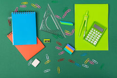 School stationery. School office stationery on green background Royalty Free Stock Images