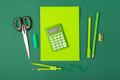 School stationery. School office stationery on green background Royalty Free Stock Image